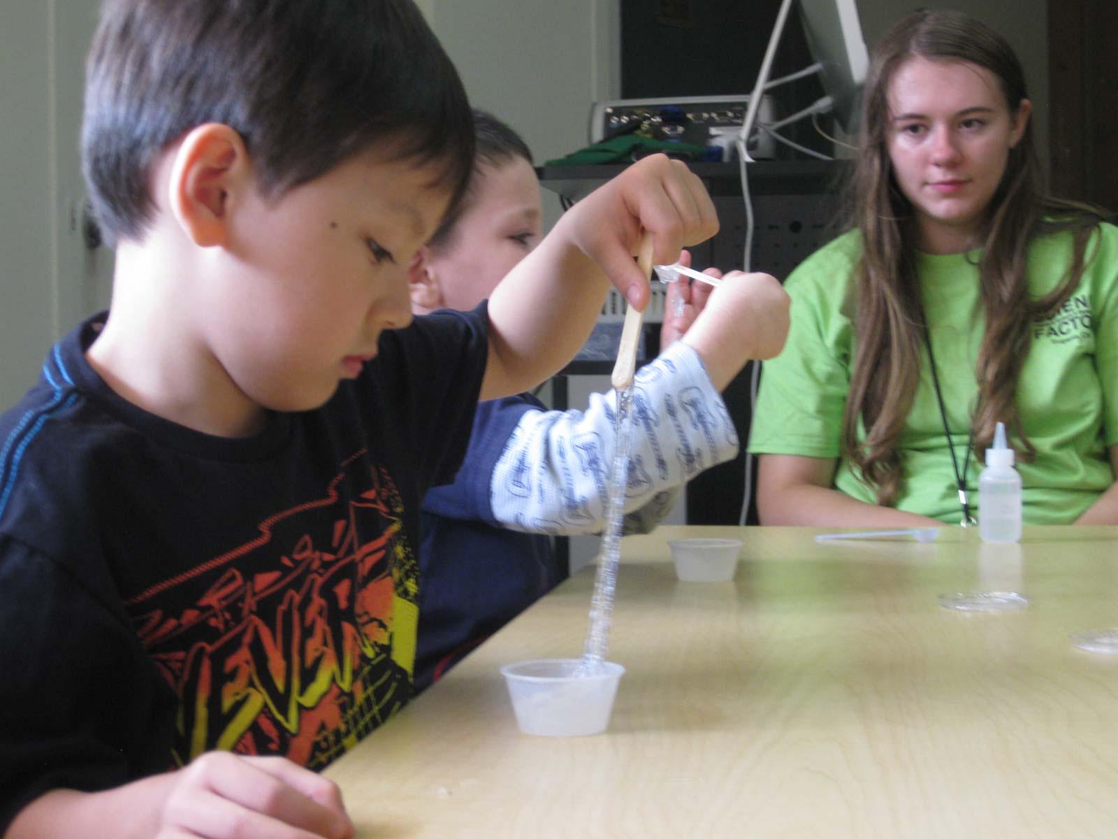 Kids Doing An Experiment