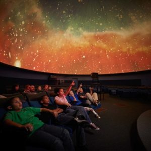 Kids pointing at planetarium
