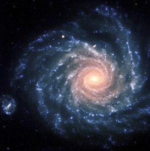 """This spectacular image of the large spiral galaxy NGC 1232 was obtained on September 21, 1998, during a period of good observing conditions. It is based on three exposures in ultra-violet, blue and red light, respectively. The colours of the different regions are well visible : the central areas contain older stars of reddish colour, while the spiral arms are populated by young, blue stars and many star-forming regions. Note the distorted companion galaxy on the left side, shaped like the greek letter """"theta"""". NGC 1232 is located 20º south of the celestial equator, in the constellation Eridanus (The River). The distance is about 100 million light-years, but the excellent optical quality of the VLT and FORS allows us to see an incredible wealth of details. At the indicated distance, the edge of the field shown corresponds to about 200,000 light-years, or about twice the size of the Milky Way galaxy. The image is a composite of three images taken behind three different filters: U (360 nm; 10 min), B (420 nm; 6 min) and R (600 nm; 2:30 min) during a period of 0.7 arcsec seeing. The field shown measures 6.8 x 6.8 arcmin. North is up; East is to the left. #L"""